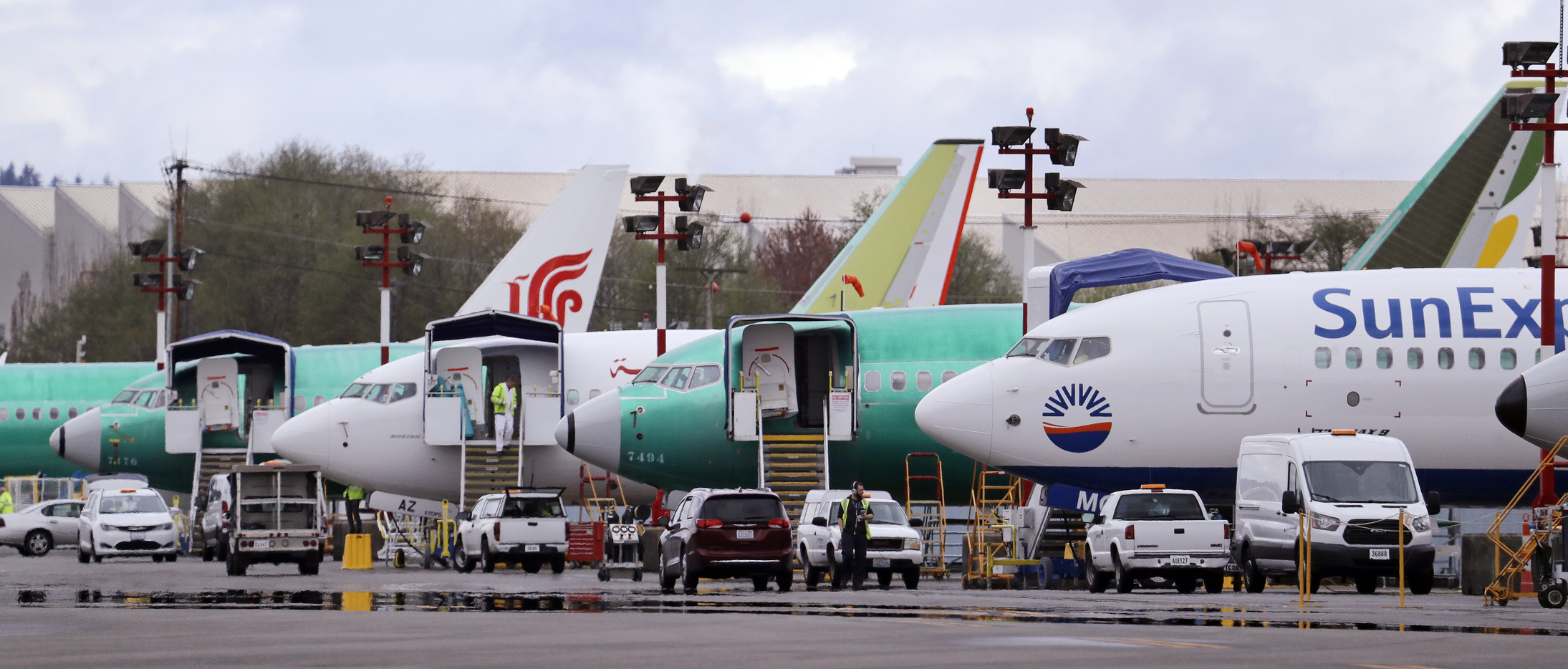 FILE - In this April 8, 2019, file photo, Boeing 737 Max aircraft are parked at the airport adjacent to a Boeing Co. production facility in Renton, Wash. From airplanes made by Boeing to apples, cherries and wheat grown by farmers, no other state is…