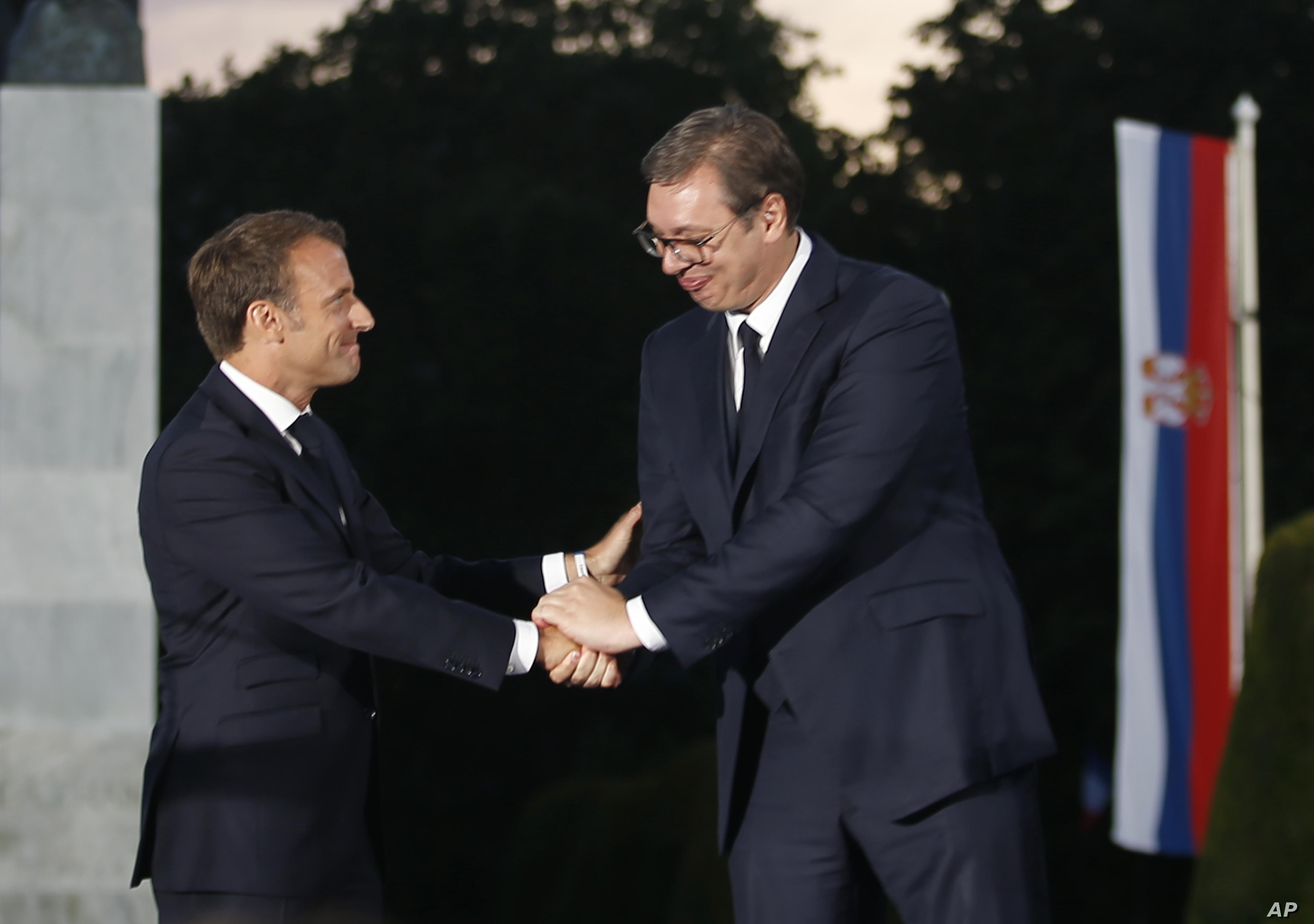 French President Emmanuel Macron, left, and Serbian President Aleksandar Vucic shake hands during an event at Veliki Kalemegdan Park in Belgrade, Serbia, Monday, July 15, 2019. French President Emmanuel Macron is for a two days official visit in…