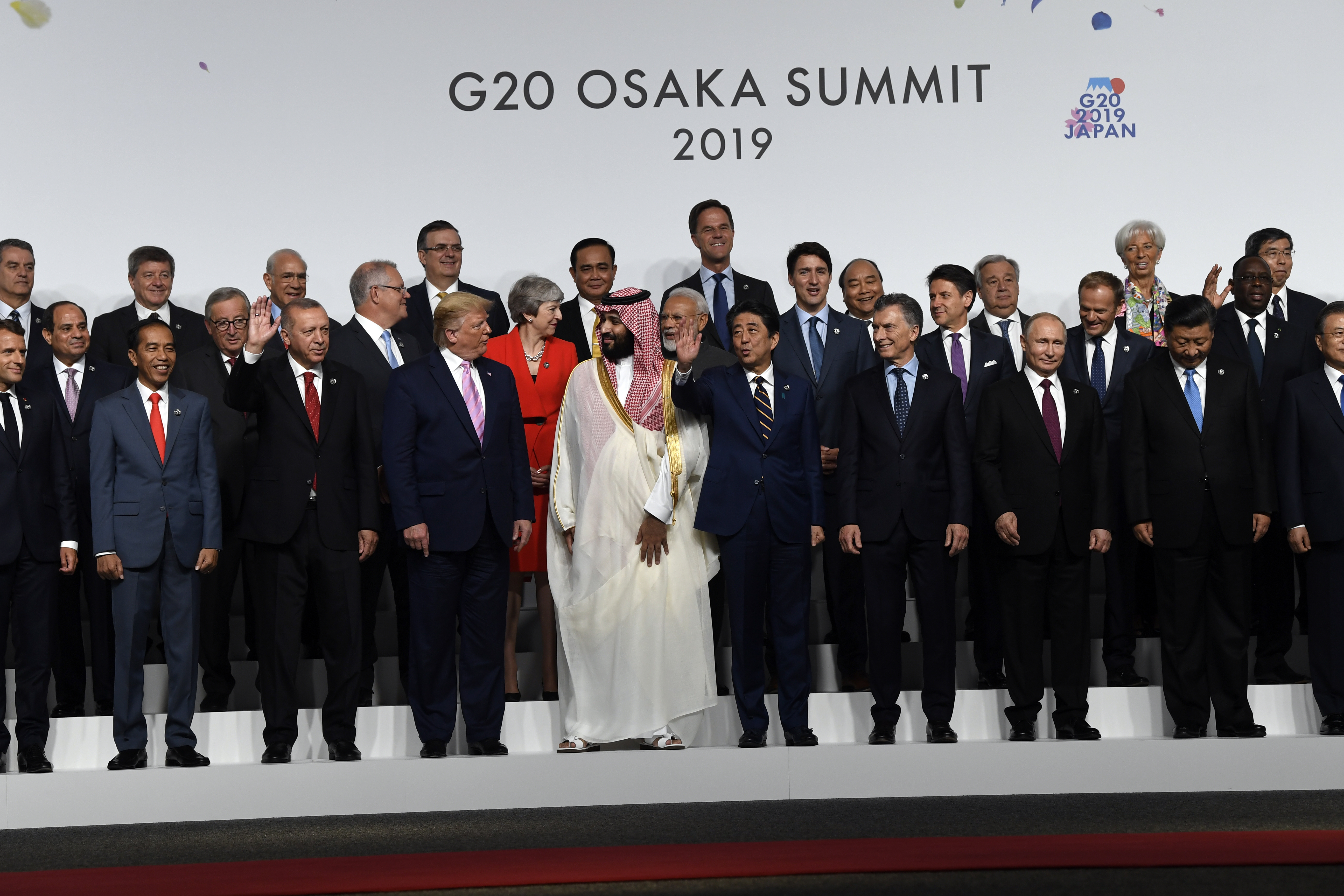 President Donald Trump and other leaders gather for a group photo at the G-20 summit in Osaka, Japan, Friday, June 28, 2019. (AP Photo/Susan Walsh)