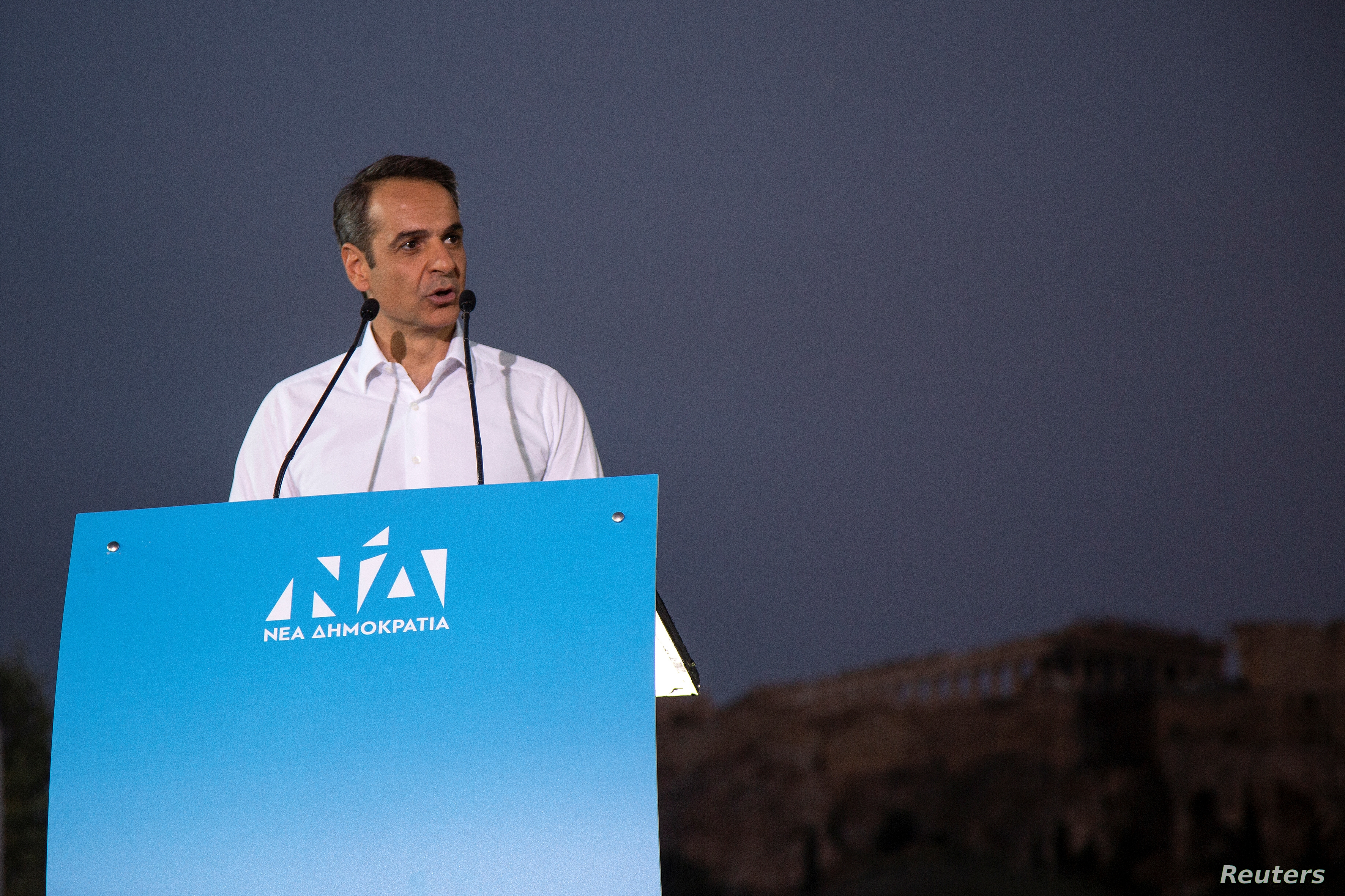 Main opposition New Democracy conservative party leader Mitsotakis addresses supporters during a pre-election rally in Athens